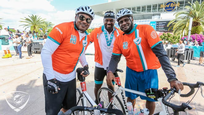 Former Dolphins (from left) Mark Duper, Chris Chambers and Troy Drayton participated in Saturday's Dolphins Cancer Challenge, which finished at Hard Rock Stadium.
