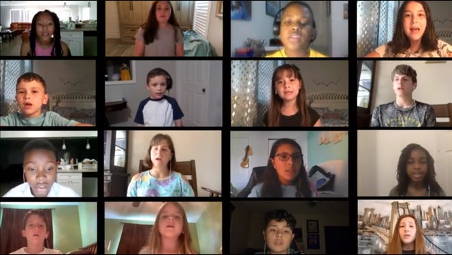 """This screen grab shows the students of Wellington Collegiate Academy's chorus singing Michael Jackson's """"Heal the World"""" via Zoom. The students sang the song in honor of first responders and others who are working on the front lines of the coronavirus pandemic."""