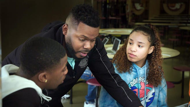 "In this image released by HBO, Mayor Michael Tubbs, center, with students Isaiah Evans, left, and Joy Almendarez in a scene from the HBO documentary ""Stockton On My Mind.""  The film dives into the dreams of an unlikely mayor, who became the community's youngest and first Black mayor in 2016, and who defied odds to lead his impoverished city."
