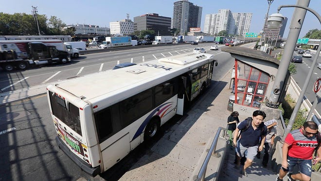 A New Jersey Transit bus drops off passengers at the first stop in Fort Lee after entering New Jersey from the George Washington Bridge.