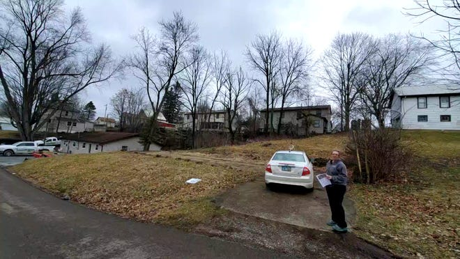 Arie Hostetler stands 629 Kenton Alley, Millersburg, where the Holmes County Habitat for Humanity will be holding a groundbreaking ceremony on July 7.
