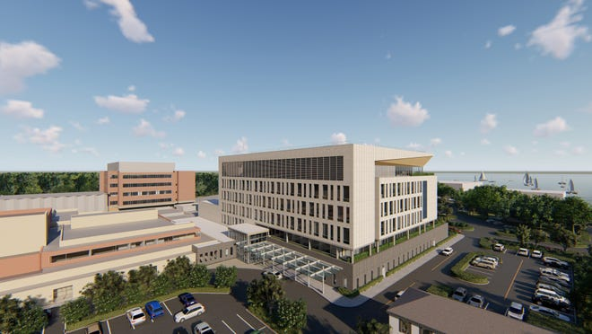 """An artist's rendering of the six-story patient care tower proposed for the Cape Cod Hospital campus. The 200,000-square-foot building was to house a cancer center, additional cardiac and medical beds and expanded intensive-care space and educational facilities. The project will be revisited once the coronavirus pandemic passes, Cape Cod Healthcare spokesman Patrick Kane said, """"but it will be scaled back."""""""