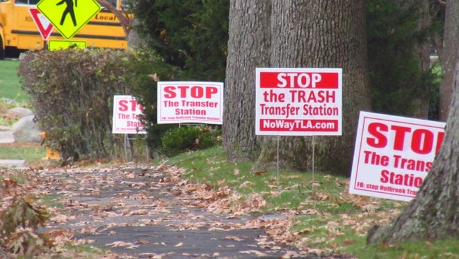 Signs protest a transfer station proposed for Holbrook. The Superior Court ruled in favor of Holbrook officials over Randolph's objections, but Randolph still could fight on.