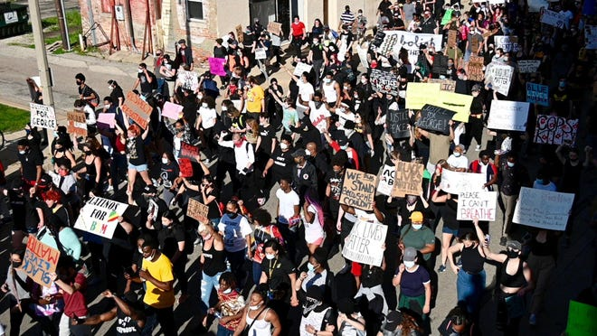 Hundreds of protesters march down Elm Street in downtown Rockford on Saturday, May 30, 2020, in response to the death of George Floyd, who was killed when a Minneapolis police officer knelt on his neck.