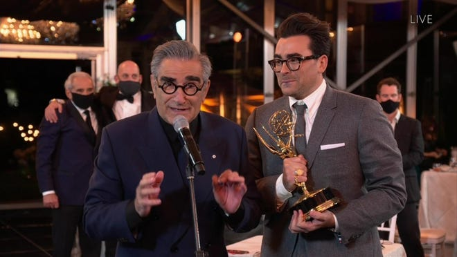 "IMAGE DISTRIBUTED FOR THE TELEVISION ACADEMY - Eugene Levy, left, and Daniel Levy from ""Schitt's Creek"" accept the Emmy for Outstanding Comedy Series during the 72nd Emmy Awards telecast on Sunday, Sept. 20, 2020 at 8:00 PM EDT/5:00 PM PDT on ABC. This is one of seven Emmy wins for ""Schitt's Creek"" tonight."