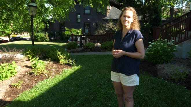 Jessica Shaw-Nolff stands in front of her rain garden in Petoskey. Courtesy photo
