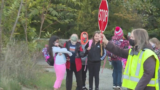 West Ottawa Public Schools crossing guard Susan Brisboe has helped students safetly cross the corner of 144th Avenue and Edmeer Drive for more than three decades before retiring last week.