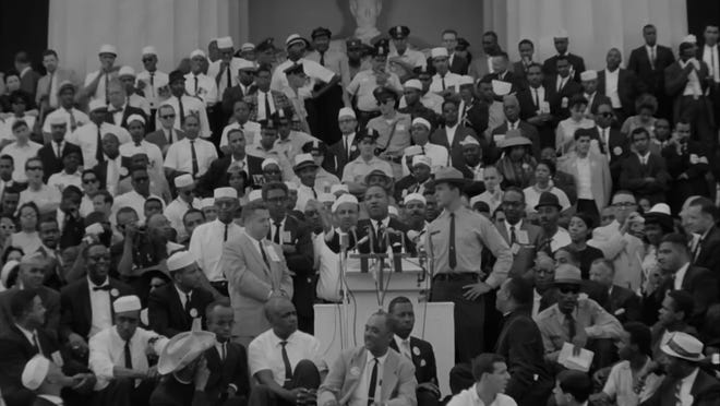 Dr. Martin Luther King Jr. enthralls the crowd at the Lincoln Memorial in 1963.