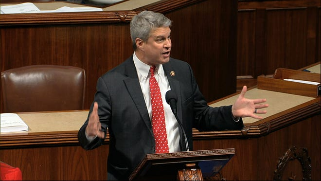 In this 2019 file photo, U.S. Rep. Bill Huizenga, R-Zeeland, speaks as the House of Representatives debates the articles of impeachment against President Donald Trump at the Capitol in Washington, Wednesday, Dec. 18, 2019. Huizenga said his reasoning for voting against impeaching Trump a second time was that Trump did not meet the definition of incitement, along with concerns impeachment could divide an already-polarized public.