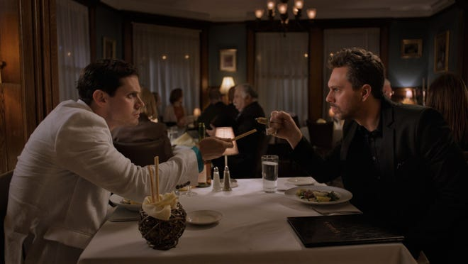 The Kid (Jake Robinson, left) and The Narrator (Thomas Sadoski) have an argumentative dinner.