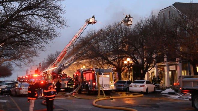 Firefighters battle a fire at 50 Main Ave. in Ocean Grove Friday.