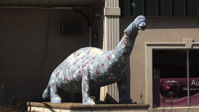 The Bayville dinosaur has stood sentinel over Route 9 for more than eight decades, enduring at least two decapitations, along with the indignity of once being painted purple and green.