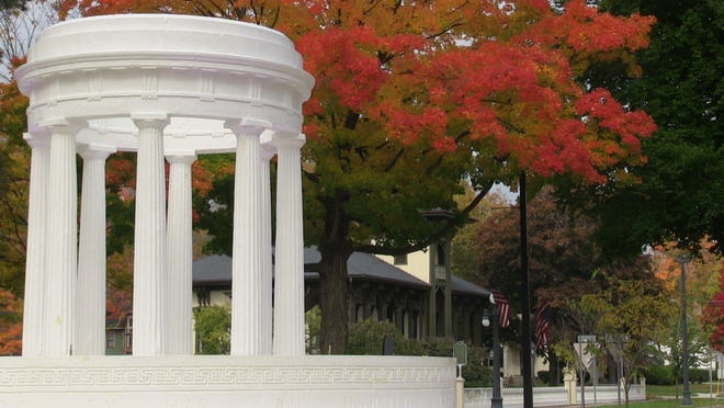 In Marshall, the Brooks Memorial Fountain and the Honolulu House sit under a fiery canopy of leaves Friday.