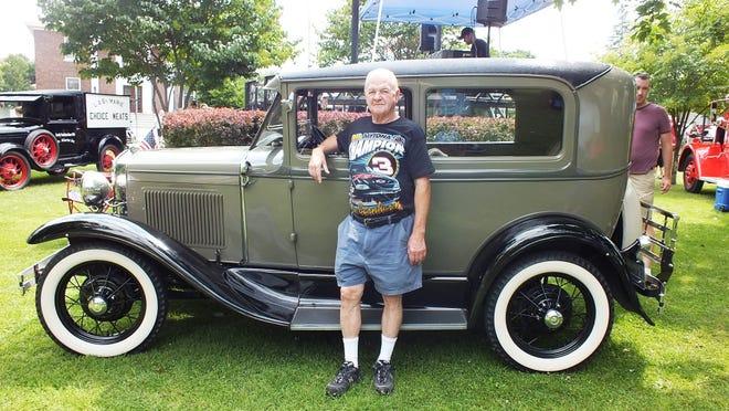 Morris St. Pierre with his 1930 Ford Model A 2-door sedan.
