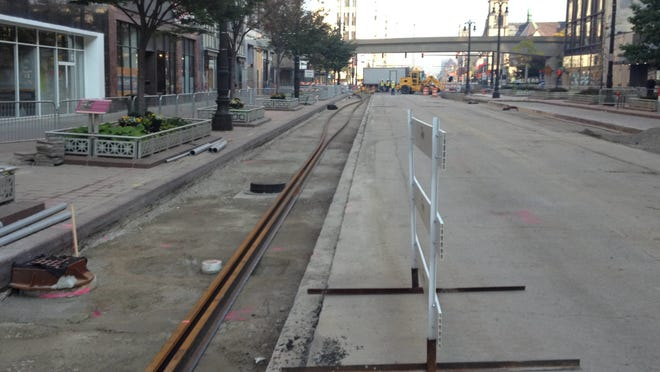 Construction crews laid down the first two rail lines on Woodward Avenue on Monday, Sept. 29, 2014.