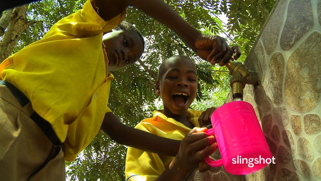 "Boys fetch water in ""SlingShot,"" a documentary about the water purification invention from Segway creator Dean Kamen. The film also explores his efforts to get kids interested in science and technology."