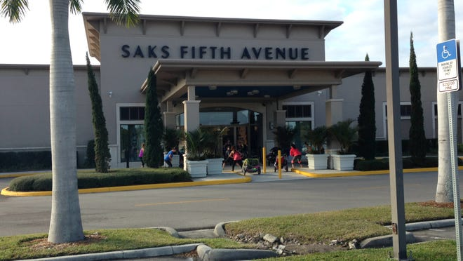 FILE: Customers wait for Saks Fifth Avenue at the Bell Tower Shops to open.