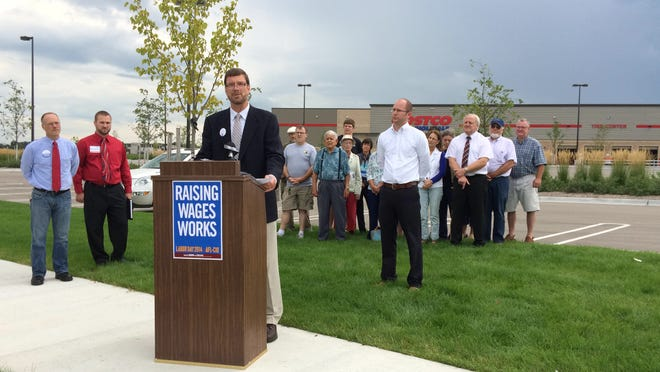 Dan Robinson, Democratic candidate for the 88th Assembly District, calls for increasing the minimum wage to $10.10 per hour during a Democratic campaign event by Costco in Bellevue Tuesday, Sept. 2.