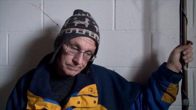 Dave Behnke of Lansing Township stands in the basement of his powerless home after the Dec. 21, 2013 ice storm. Behnke, who went 10 days without power, called his neighborhood the forgotten zone. He chased and fought thieves who stole his generator.
