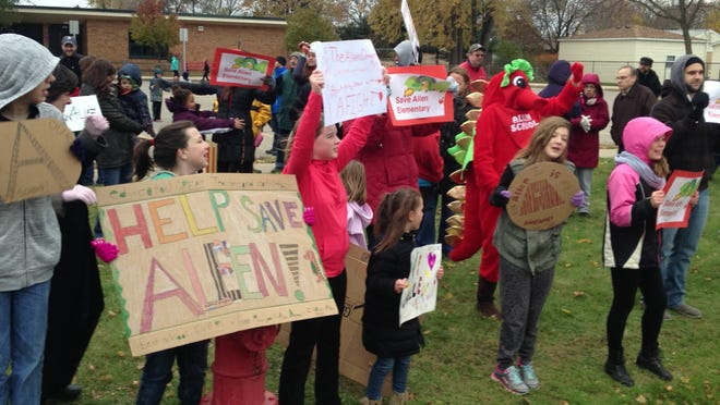 Parents, kids and supporters crowded the curb in front of Allen Elementary School on Haggerty in Plymouth Township Sunday to show support for the school. On Tuesday, the Board of Education voted to close it.