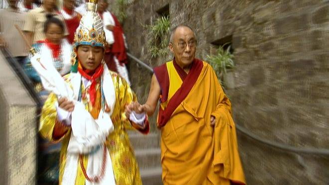 The king of Tibet, Namgyal Wangchuk Lhagyari Trichen, now a sophomore at Gettysburg College in Pennsylvania, is pictured a decade ago at his coronation with the Dalai Lama, his personal mentor.