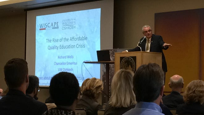 University of Wisconsin-Oshkosh Chancellor Emeritus Richard Wells talks about the college affordability crisis Thursday, Oct. 16, 2014, during a one-day UW System forum at the UWO Alumni Welcome and Conference Center.