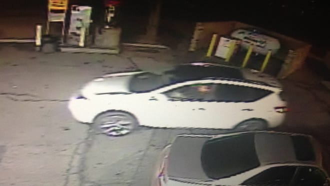 In this security footage screen shot, a white SUV, driven by an unidentified homicide suspect, enters the Shell gas station parking lot last Wednesday. Police say one of the occupants of this vehicle shot Conrado Pizarro, 26, killing him. The killing was captured by security cameras at the gas station.