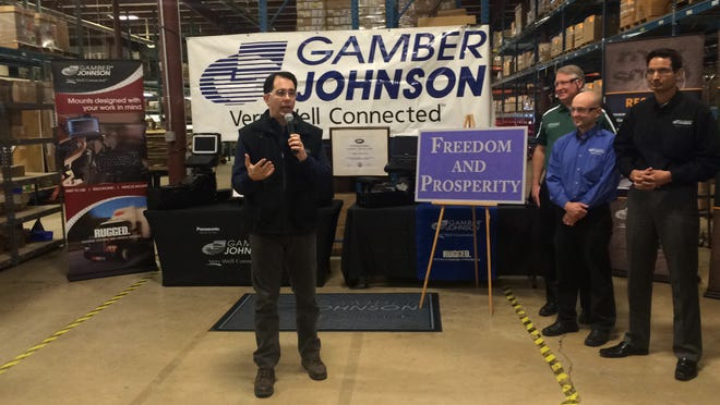 Wisconsin Gov. Scott Walker gives remarks during a tour of Gamber Johnson, a company which builds systems for mounting electronics in vehicles, on Wednesday in Stevens Point as part of a tour of the state a day after he gave his budget address to the State Legislature.