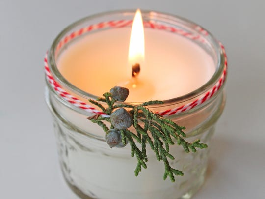 Wrap baker's twine around a nice-smelling candle and use it to secure a small sprig of evergreen for a simple holiday touch.