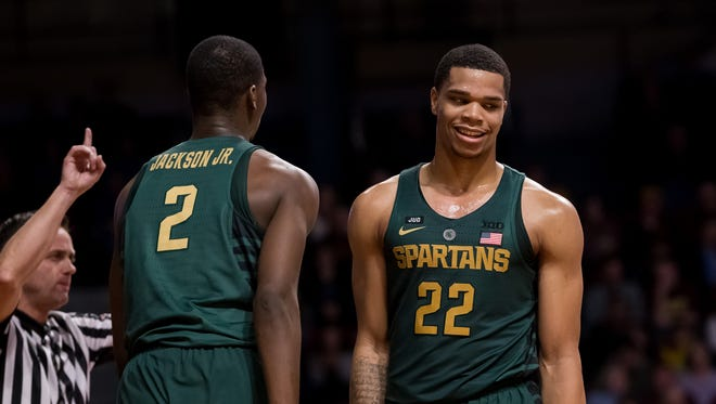 Feb 13, 2018; Minneapolis, MN, USA; Michigan State's Jaren Jackson Jr. (2) and guard Miles Bridges react after a foul in the first half against Minnesota at Williams Arena.
