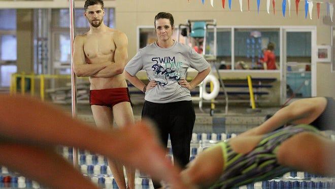 Kristi Lucero, right, and Colton Grossheim watch over practice of the Farmington and Piedra Vista swim teams on Dec. 22 at the Farmington Aquatic Center.