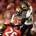 Missouri defensive backs Logan Cheadle (28) and Kenya Dennis (7) break up a pass indented for Georgia wide receiver Malcolm Mitchell (26) in the first half of an NCAA college football game Saturday, Oct. 17, 2015, in Athens, Ga.