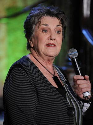 In this June 2, 2009 photo, Australian veteran actress Maggie Kirkpatrick speaks about the production of stage show Wicked at a media call in Sydney, Australia.