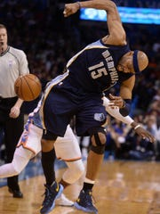 Memphis Grizzlies guard Vince Carter (15) loses control of the ball as Oklahoma City Thunder guard Victor Oladipo (5) attempts a steal during the second quarter at Chesapeake Energy Arena.