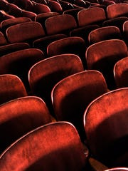 The 70 year-old chairs from the Majestic Theatre are lined up inside Eastland's Lyric Theatre Thursday Sept. 14, 2017 where they are being temporarily stored. The chairs are available for purchase from the Majestic.