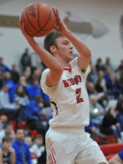 Bucyrus' Harley Robinson dishes out a pass after driving