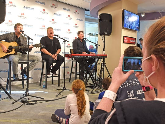 Christina Perry takes a photo from her front row seat as Rascal Flatts visited Monroe Carell Jr. Children's Hospital at Vanderbilt on Monday, Nov. 7, 2016, for a special performance at the Seacrest Studios for the patients.