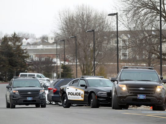 Police vehicles in the front entrance of West High