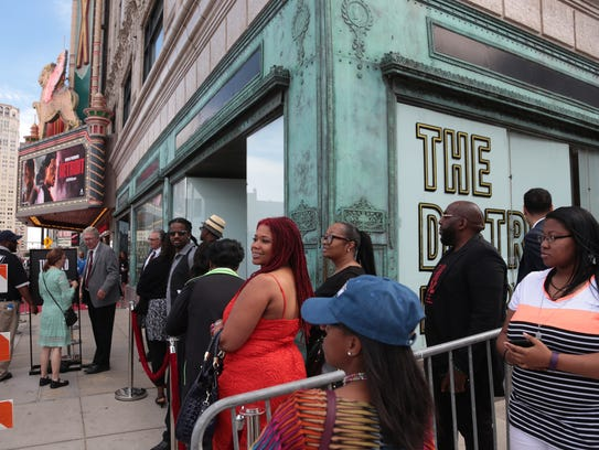People wait to enter the Fox Theater in Detroit on