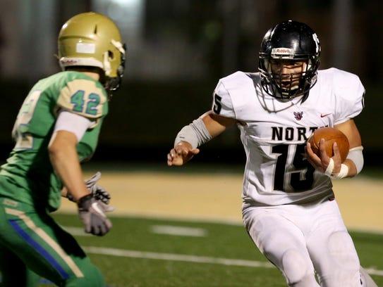 North Salem's Rigo Padilla (15) tries to move past