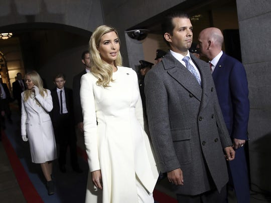 Ivanka Trump and Donald Trump, Jr. arrive on the West Front of the U.S. Capitol on Friday.