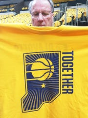 Pacers executive Bill Benner shows off one of the 19,123 shirts placed for fans in Bankers Life Fieldhouse ahead of Game 3 of the Eastern Conference Playoffs.