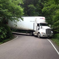 Signs along Vermont 108 attempt to dissuade tractor-trailer drivers from continuing into Smugglers Notch. State officials say some drivers ignore the warnings, relying on GPS directions.