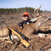 Six-year-old Katy Lou Moore of Pensacola with nice deer she shot while hunting with her father, Brennen Moore, in Camden, Ala.