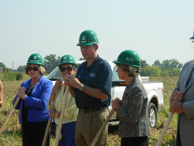 Don Jenkins, center, speaks to the crowd before breaking ground at the new Jenkins and Wynne  Dealership near 101st Parkway and Trenton Road.