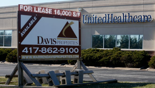 A for lease sign sits in front of the UnitedHealthcare building at Kansas Expressway and Bennett Street on Thursday, Jan. 14, 2015. The company is vacating nearly 50,000 square feet of office space in Springfield, and has asked its employees to work from home.