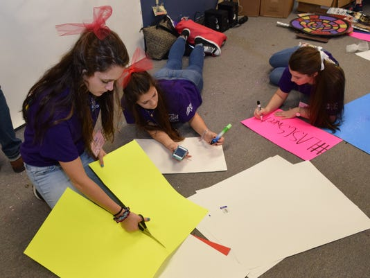 Pineville High School student council members junior Mia Smith (left), senior Rebecca Martin and junior Samantha Favors make signs  Saturday as the school's student council members prepare to host the Louisiana Association of Student Councils Saturday. Abo
