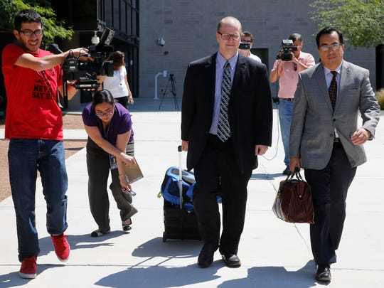 James Anderson, center, former assistant superintendent for secondary schools at the El Paso Independent School District, leaves the Federal Courthouse with his attorney.