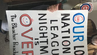 Cubs fan Jerry Pritikin holds a sign he made for the 2016 National League Championship Series. Pritikin went to his first Cubs game in 1945, the last year the Cubs went to the World Series.