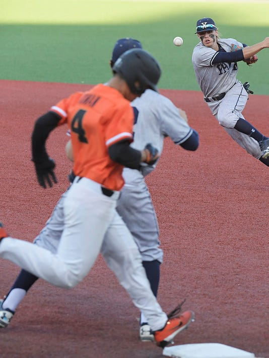 Yale second baseman Simon Whiteman throws to first baseman Griffin Dey as Oregon State's Steven Kwan legs out a bunt base hit during an NCAA college baseball regional tournament game in Corvallis, Ore., Sunday, June 4, 2017. (Mark Ylen/Albany Democrat-Herald via AP)